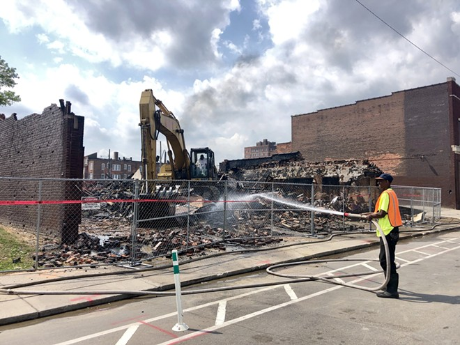 A crew demolishes the Gold Dollar in the Cass Corridor. - STEVE NEAVLING