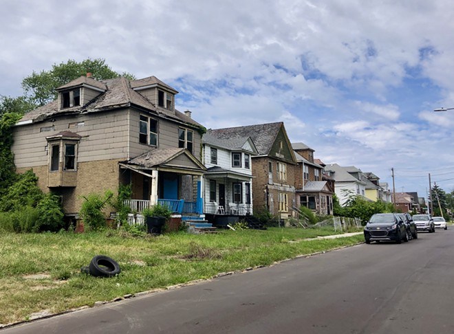 Row of occupied and abandoned homes on Detroit's east side. - STEVE NEAVLING
