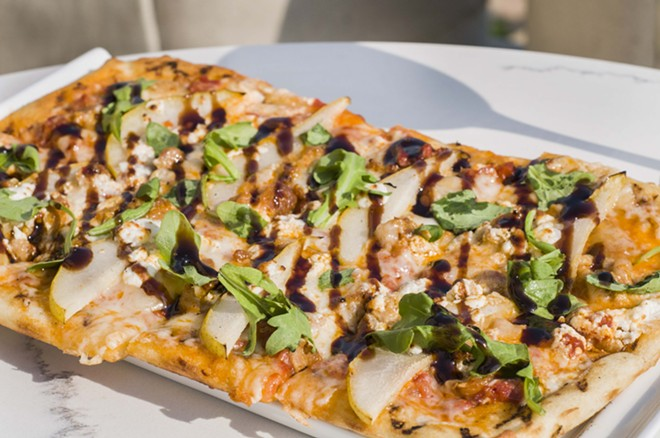 Flatbread with Italian sausage, marinara, garlic confit, goat cheese, fontina, roasted pears, arugula, balsamic. - TOM PERKINS