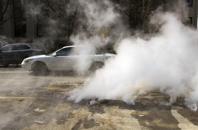 Billowing steam in Detroit. - STEVE NEAVLING
