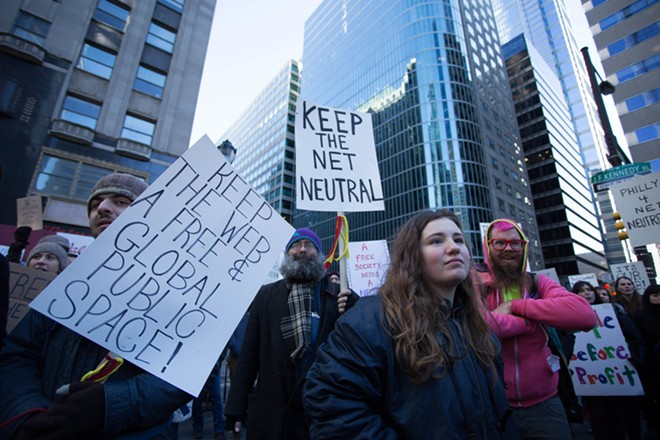 Protestors advocating for net neutrality rally outside the headquarters of the Comcast Corporation in Philadelphia, Saturday, Jan. 13, 2018. - MICHAEL CANDELORI / SHUTTERSTOCK.COM