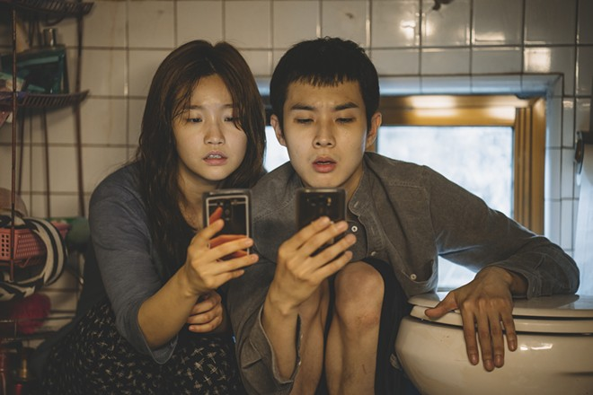 Ki-jung Kim (So-dam Park) and Ki-woo Park (Woo-sik Choi) in Parasite. - COURTESY OF NEON CJ ENTERTAINMENT