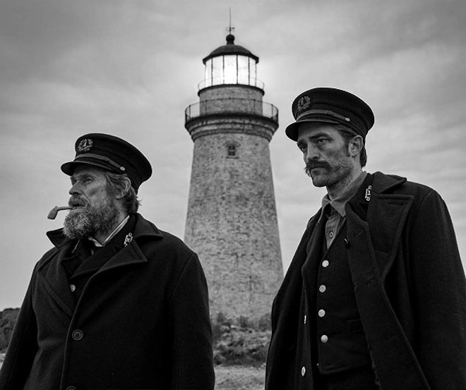 Willem Dafoe and Robert Pattinson in The Lighthouse. - PHOTO VIA A24