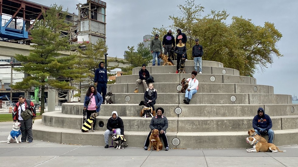 Motor City K9 Solutions hosted a recent dog walk in Detroit to help promote the importance of socializing dogs. - COURTESY OF MOTOR CITY K9 SOLUTIONS