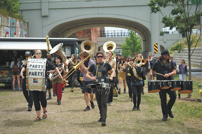 DPMB performing along the Dequindre Cut in 2018. - TJ SAMUELS