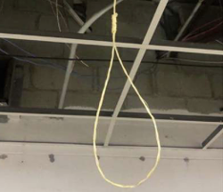 Suspected noose hanging from a ceiling in the lobby of the Detroit Police Department's 11th precinct. - DPD