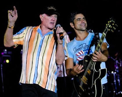 NOTE: John Stamos will not be joining the Beach Boys for their area show... or will he? - GIBSON PROMOTIONAL PHOTO