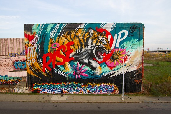 Australian artist Meggs, who painted the above mural in Detroit last fall, kicks off the new Murals In the Market festival with the unveiling of a new painting on Tuesday. - SAL RODRIGUEZ