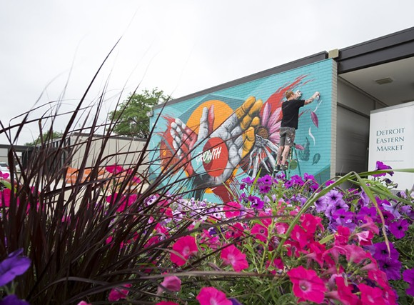 Meggs puts the finishing touches on his latest Detroit mural. - COURTESY PHOTO