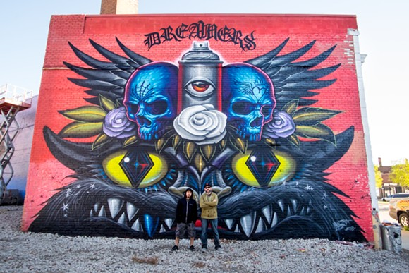 Los Angeles-based artists Jeff Soto and Maxx242 stand in front of their finished mural for 1xRUN's Murals in the Market. - SAL RODRIGUEZ