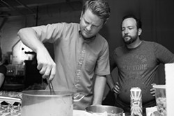 Joe Robinson, left, Brendon Edwards, right, during a popup dinner over the summer. - PHOTO BY JENNA BELEVENDER