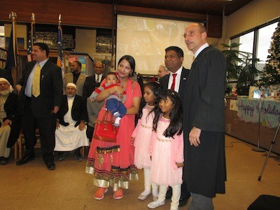 The Musa family poses with Judge Paruk.