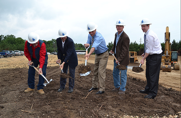 The men of the KWA, including Genesee County Drain Commissioner/KWA CEO Jeff Wright (center) and Flint Mayor Dayne Walling (far right) break ground for the new pipeline.