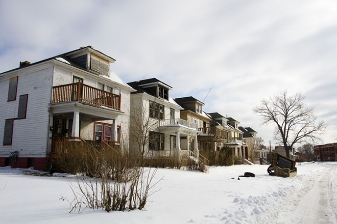 Blighted, neglected street in Detroit, decimated by foreclosures. - STEVE NEAVLING