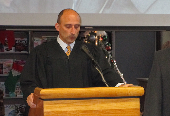 Judge Paul J. Paruk presiding over the inauguration of incoming and re-elected members of Hamtramck's City Council this January. - PHOTO BY MICHAEL JACKMAN