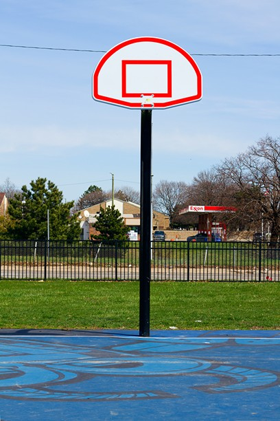 The city has begun removing basketball rims at parks to discourage clusters of people. - STEVE NEAVLING