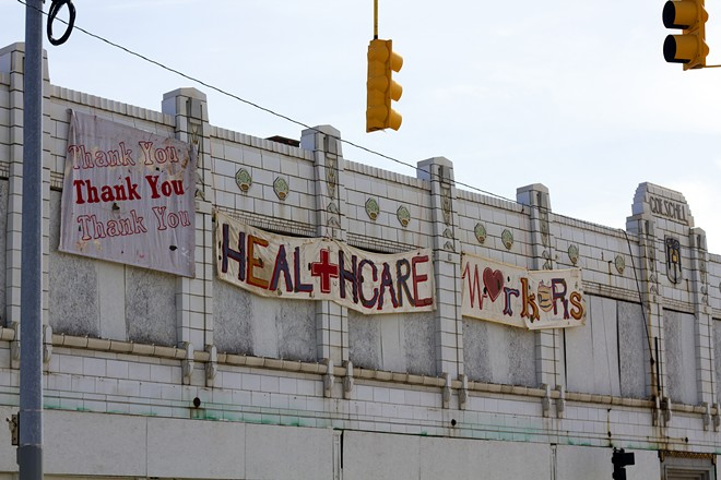 A sign of support for health care workers on the vacant Goeschel building on Gratiot in Detroit. - STEVE NEAVLING