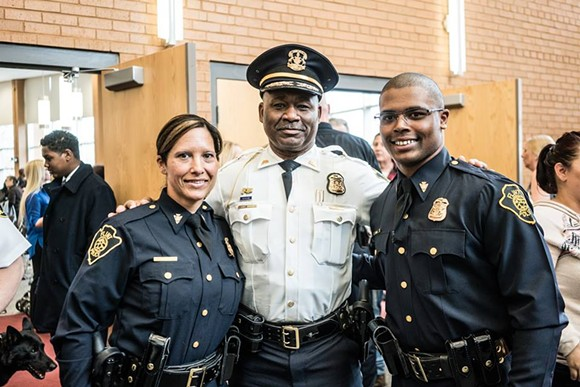 Maria and Dion Reed with Chief Johnson at the swearing in. - CITY OF FLINT POLICE DEPARTMENT ON FACEBOOK