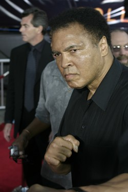 Muhammad Ali at the Los Angeles premiere of 'Collateral' held at the Orpheum Theatre in Los Angeles, USA on August 2, 2004 | Photo credit: Tinseltown / Shutterstock.com