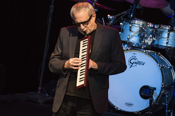 Steely Dan's Donald Fagen plays a melodica during a Wednesday show at DTE Energy Music Theater. - PHOTO BY MIKE FERDINANDE.