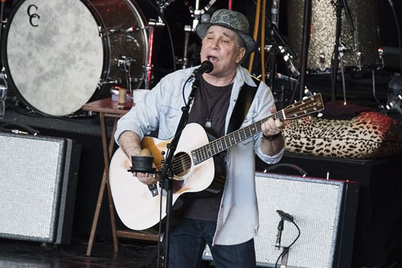 Paul Simon in front of a full house at Meadow Brook Amphitheatre on Sunday. - PHOTO BY MIKE FERDINANDE