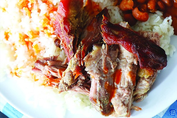 PERNIL, ROASTED PORK SHOULDER WITH WHITE RICE AND WHOLE BEANS. | PHOTO/SCOTT SPELLMAN
