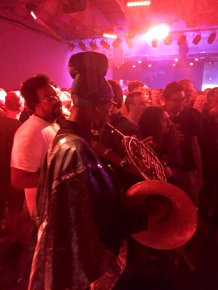 A member of the Arkestra weaves through the audience during the concert at El Club. Photo by Dustin Blitchok.