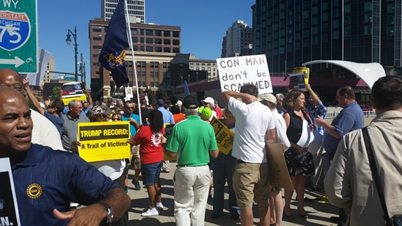 ANTI-TRUMP PROTESTERS OUTSIDE THE COBO CENTER | PHOTO BY AARON ROBERTSON