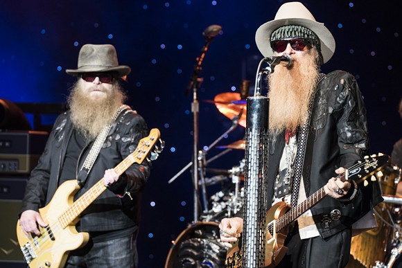 Dusty Hill, left, and Billy Gibbons of ZZ Top at DTE Energy Music Theatre on Wednesday. - PHOTO BY MIKE FERDINANDE