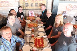 Mayor Karen Majewski and friends dig into the new Hamtramck Special at Buddy's Rendezvous. - COURTESY OF BUDDY'S PIZZA