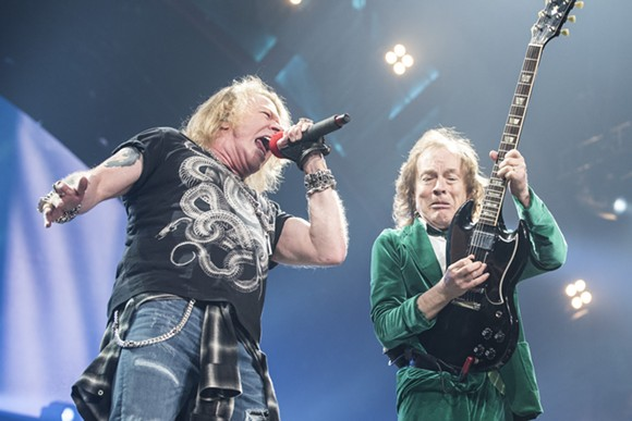 Axl Rose and Angus Young onstage at The Palace of Auburn Hills on Friday. - PHOTO BY MIKE FERDINANDE