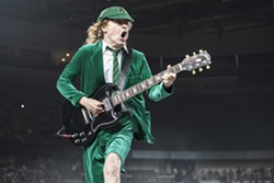 Angus Young shreds during Friday's AC/DC make-up date at the Palace. - PHOTO BY MIKE FERDINANDE