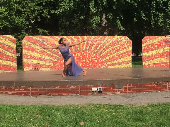 """The Detroit-Windsor Dance Academy's Amber Moore performs """"Crowned"""" during an Open Streets event at Clark Park on Tuesday. - PHOTO BY JENNIFER MCDONNELL."""