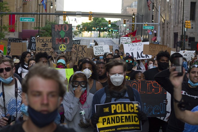 Protesters march in downtown Detroit on Thursday. - STEVE NEAVLING