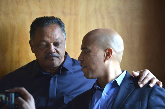 The Rev. Jesse Jackson and U.S. Sen. Cory Booker chat Thursday at Kuzzo's Chicken & Waffles in Detroit. - PHOTO BY DUSTIN BLITCHOK