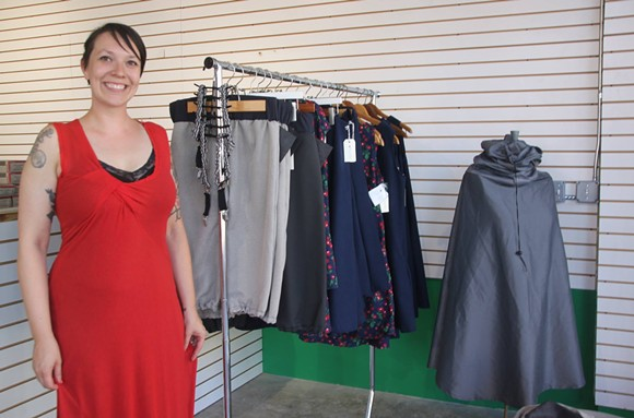 William + Bonnie owner Sarah Ayres stands with some clothing options that will be for sale at Wheelhouse Hamtramck.