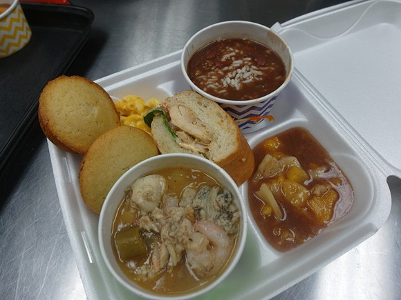 Front, the premium seafood gumbo, Poor Boy sandwich center, cornbread and mac 'n cheese left, peach cobbler right, and red beans and rice back. - ALL PHOTOS BY SERENA MARIA DANIELS