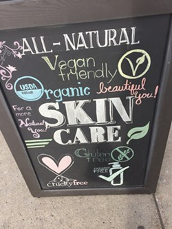 """Advertisement for """"gluten-free"""" beauty products taken outside a store in Buffalo, New York. - PHOTO BY JANE SLAUGHTER"""