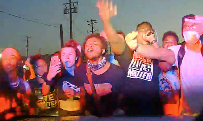 Screen grab of video inside Detroit police car that drove through a crowd of protesters. - DPD
