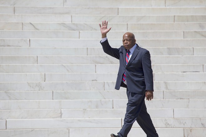 Georgia Congressman John Lewis waves at the 50th Anniversary of the march on Washington and Martin Luther King's I Have A Dream Speech in 2013. - JOSEPH SOHM, SHUTTERSTOCK