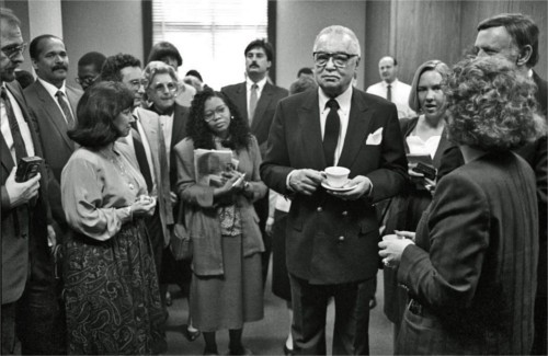 "Mayor Coleman Young in the one-time roost of Orville Hubbard? It happened. Harkness says, ""Coleman Young spent a half-day in Dearborn for the annual Mayor Exchange Day, while Mayor Michael A. Guido went to Detroit, in May of 1991. This photo was taken in a reception room in the old Dearborn City Hall."" - PHOTO COURTESY BRUCE HARKNESS"