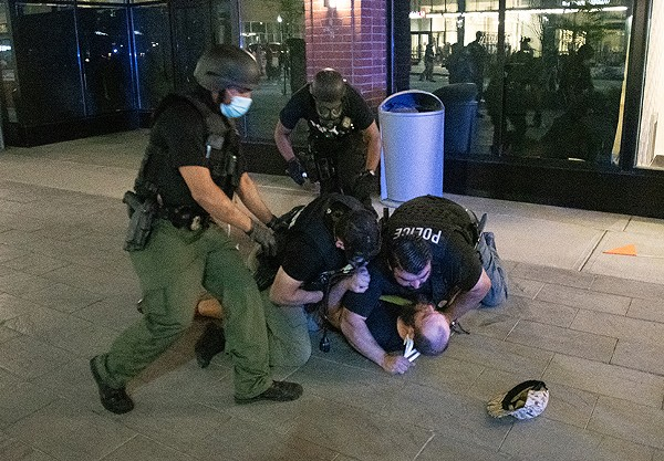 Detroit police tackle a protester early Sunday morning. - ADAM J. DEWEY