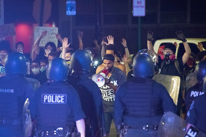 Police clashed with protesters on Woodward on Sunday morning. - ADAM J. DEWEY