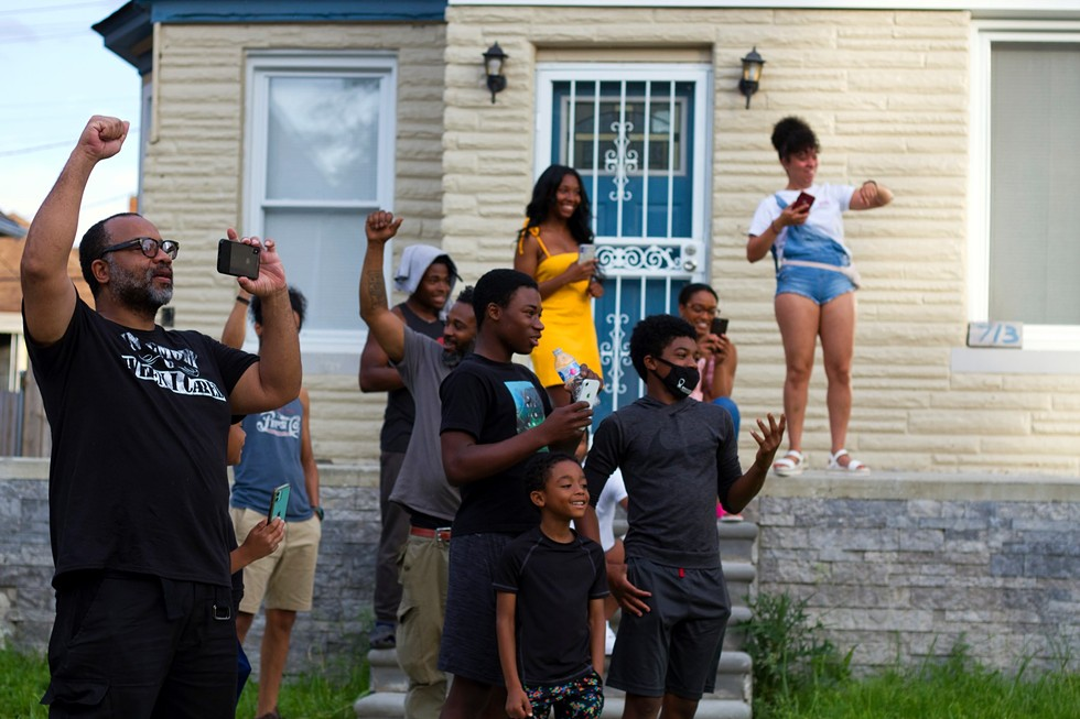 Detroiters came out of their homes to support protesters near the intersection formerly known as 12th and Clairmount — the location of the incident that sparked the city's bloody 1967 summer of civil unrest. - STEVE NEAVLING