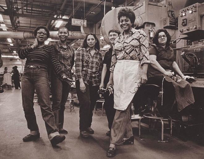 """Press Operators, GM Fisher Body Trim Plant, Fort Street, Detroit Michigan,"" 1982, Russ Marshall, American; gelatin silver print. - COURTESY OF THE DIA"