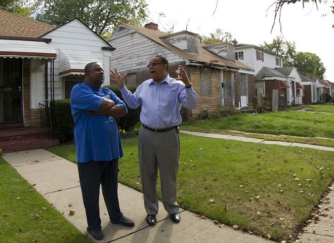 Wayne County Sheriff Benny Napoleon (right) talks with a Detroit resident during his 2013 campaign for mayor. - SAVE NEAVLING