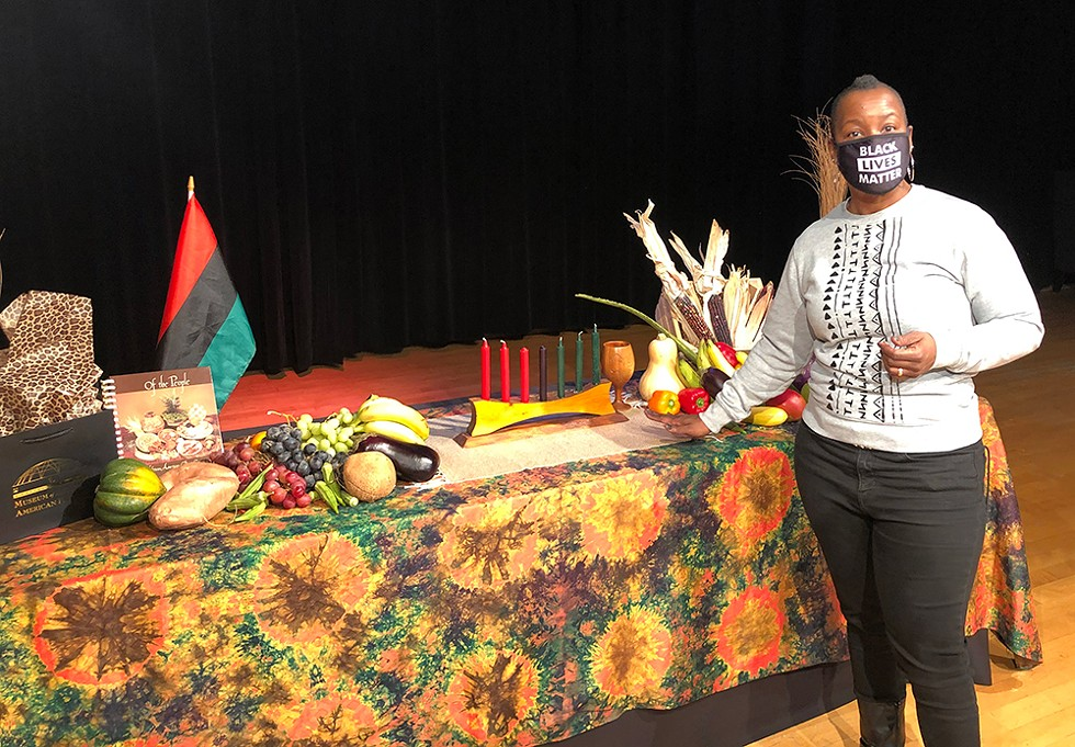 """""""I want the energy and the excitement and enthusiasm about Kwanzaa to infect everybody,"""" Yolanda Jack of the Charles H. Wright Museum of African American History says. """"Because I believe that everybody can benefit from it."""" - LEE DEVITO"""