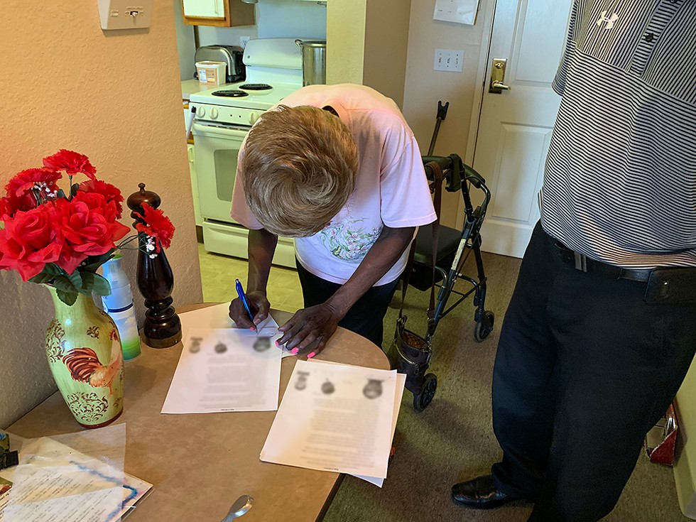Barbara Hill signs an affidavit swearing that Ray Gray is in fact an innocent man. - PHOTO BY BILL PROCTOR