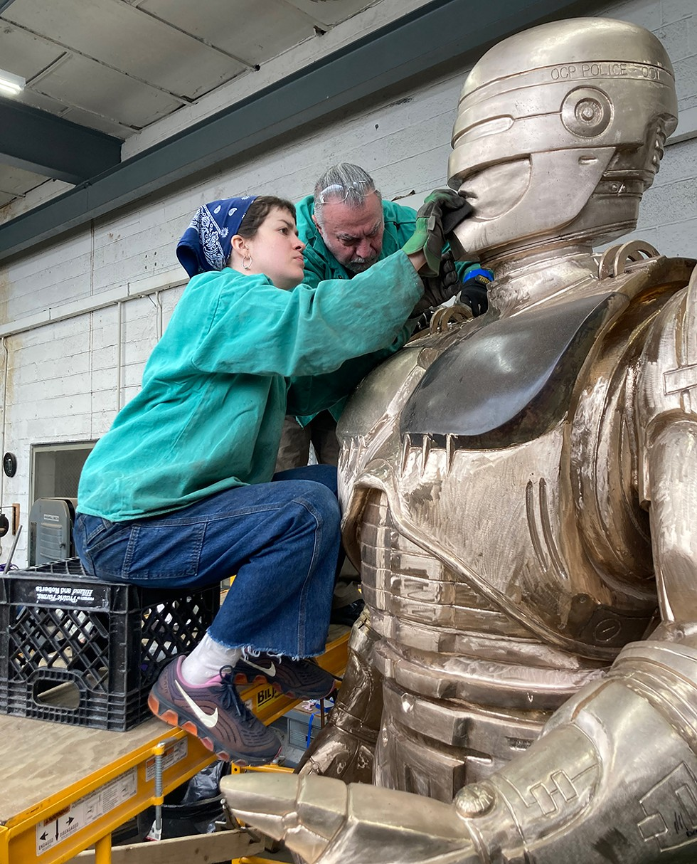 Venus Bronze Works' Giorgio Gikas, center, puts the finishing touches on Detroit's long-awaited RoboCop statue, with help from assistant Nadine Chronopoulos. Now the statue just needs a home. - JAY JURMA