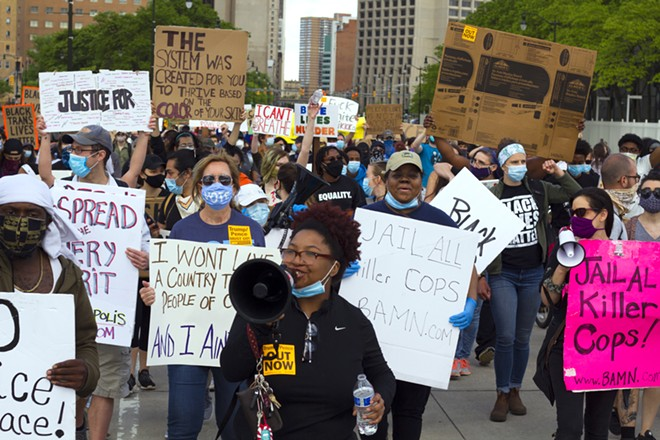 Nakia Wallace, in center with a megaphone, marches with protesters in June 2020. - STEVE NEAVLING